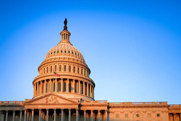 The United States Capitol building at sunrise stock photo