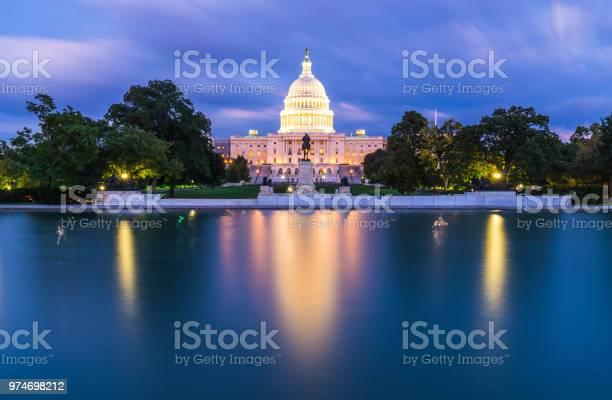 The united states capitol building at twilight wirth reflection in picture id974698212?b=1&k=6&m=974698212&s=612x612&h=v0miaosvuqdyj0mq9 txmf9vyeanvohkaooqczomrqg=