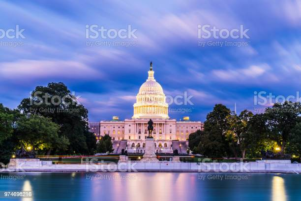 The united states capitol building at twilight wirth reflection in picture id974698216?b=1&k=6&m=974698216&s=612x612&h=gbypxuq2bv31zcoib6gi72aguajg8wr88chyaaneq7i=