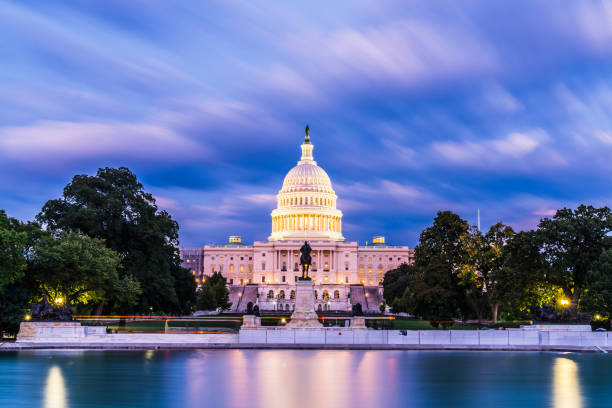 The United States Capitol building at twilight wirth reflection in water. The United States Capitol building at twilight wirth reflection in water. capitol building washington dc stock pictures, royalty-free photos & images