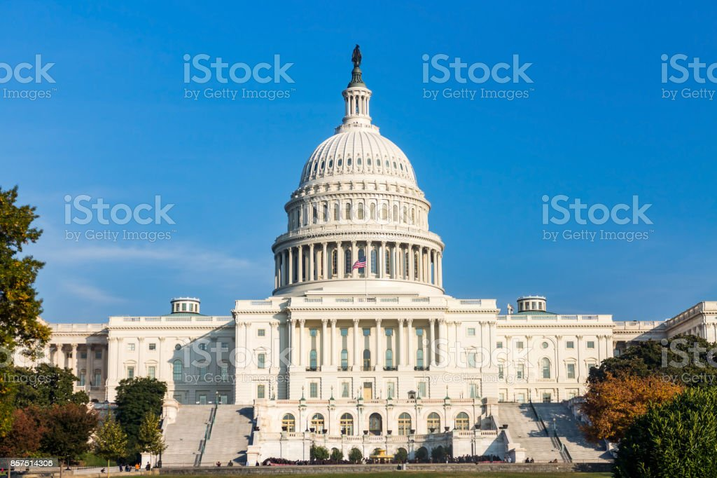 The United States capitol builing on a sunny day. stock photo
