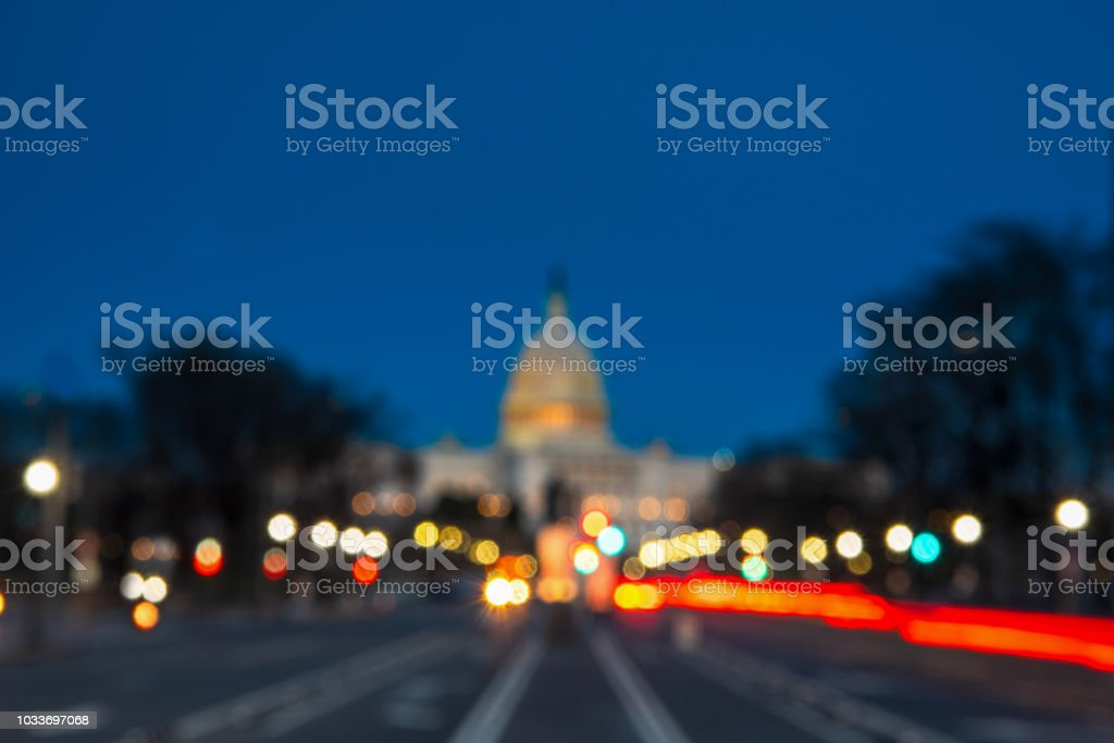 The United States Capitol with Blurred Background after sunset The United States Capitol with Blurred Background after sunset Advertisement Stock Photo