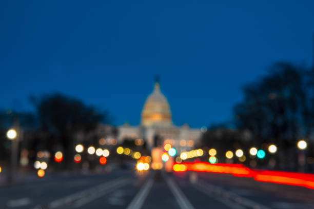 The United States Capitol with Blurred Background after sunset The United States Capitol with Blurred Background after sunset federal building stock pictures, royalty-free photos & images
