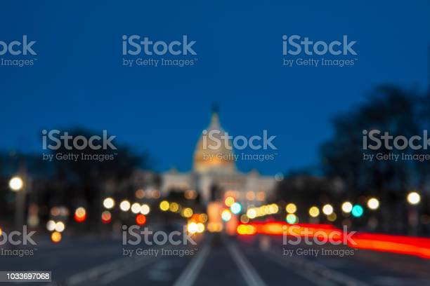 The United States Capitol With Blurred Background After Sunset Stock Photo - Download Image Now