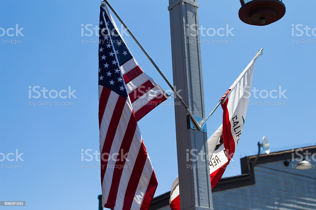The United States flag with California flag stock photo