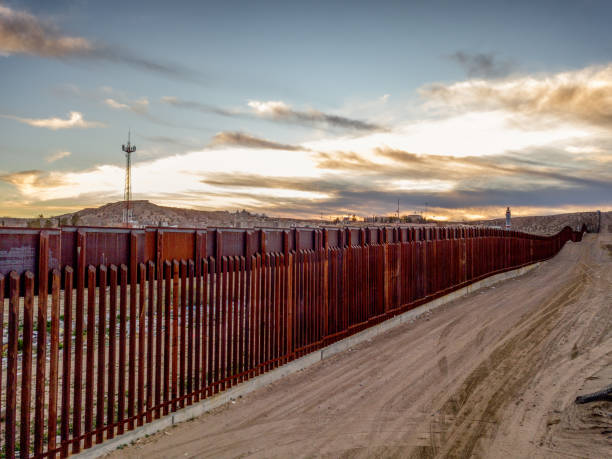 The United States Mexico International Border Wall between Sunland Park New Mexico and Puerto Anapra, Chihuahua Mexico stock photo
