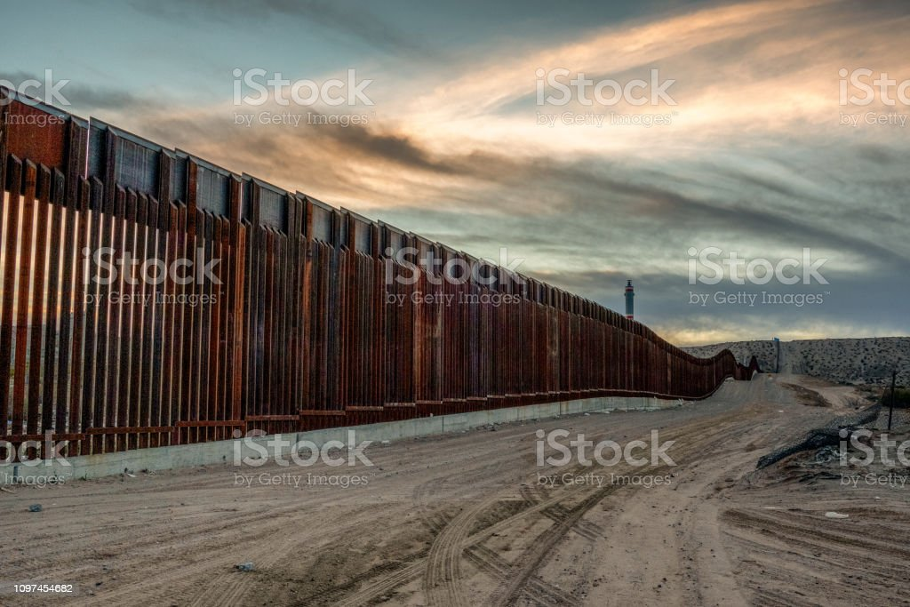 The United States Mexico International Border Wall between Sunland Park New Mexico and Puerto Anapra, Chihuahua Mexico royalty-free stock photo