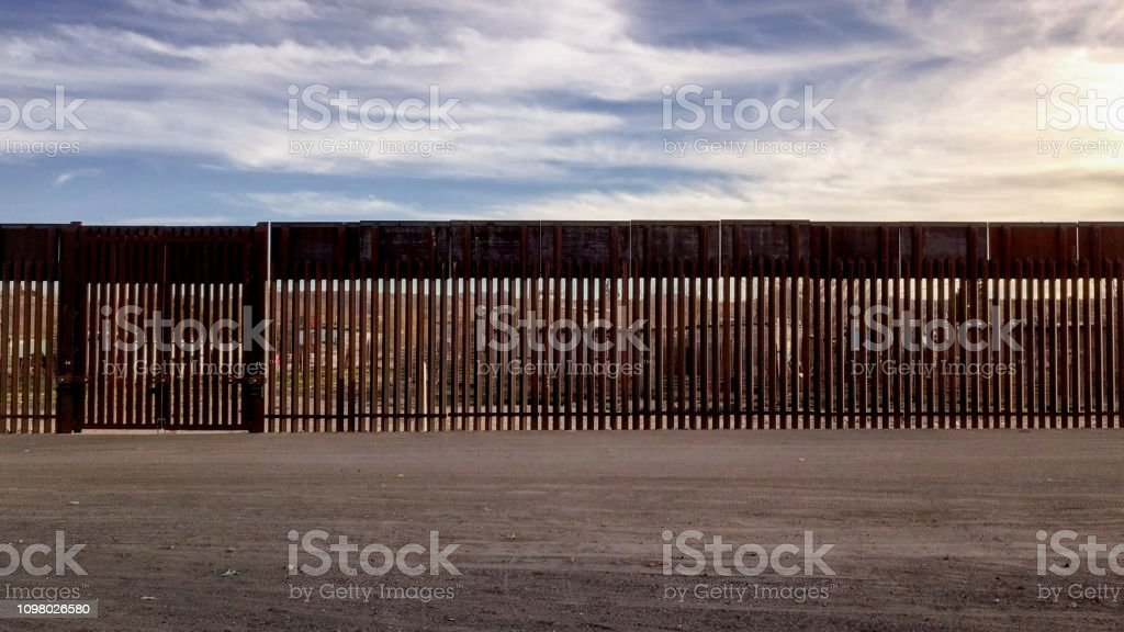 The iconic and controversial iron border wall between the USA and...
