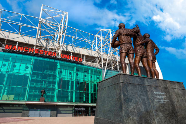 The United Trinity bronze sculpture at Old Trafford stadium in Manchester, UK stock photo
