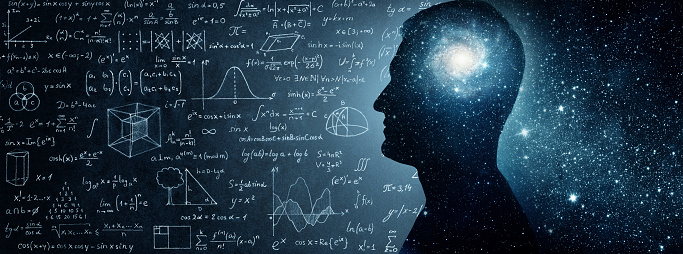 istock The universe within. Silhouette of a man inside the universe, physical and mathematical formulas.. 1012505922