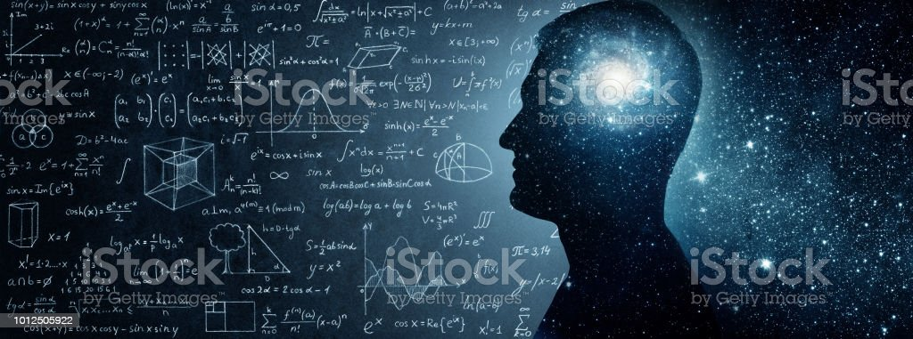 The universe within. Silhouette of a man inside the universe, physical and mathematical formulas.. stock photo