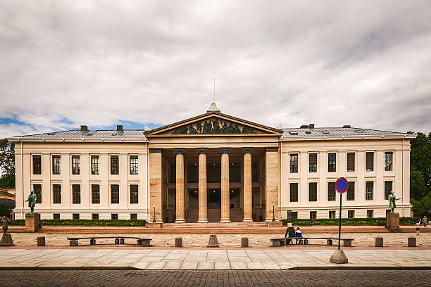The University of Oslo (Universitetsplassen) Oslo, Norway - July 18, 2016: People sitting on a bench in front of the University (Universitetsplassen) of Oslo's historic Faculty of Law on Karl Johans Gate in the heart of Oslo, Norway's vibrant capital city.  university of oslo stock pictures, royalty-free photos & images