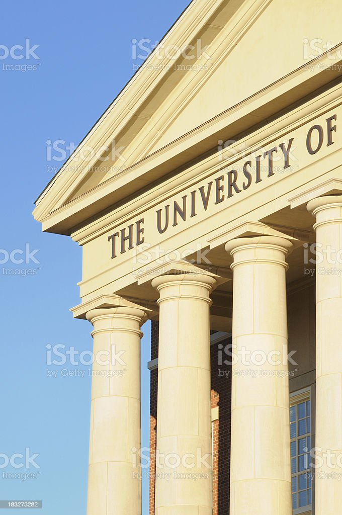 The university of sign on building stock photo