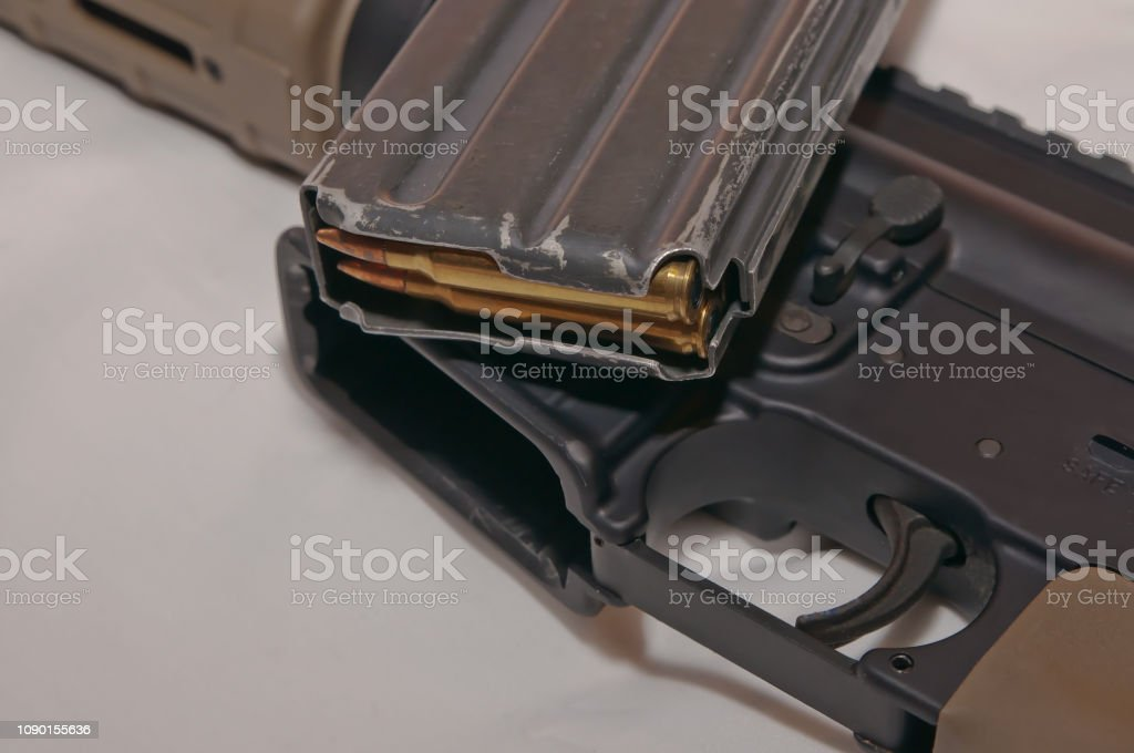 The Upper Of A Black And Brown 223 Caliber Ar15 Rifle With A