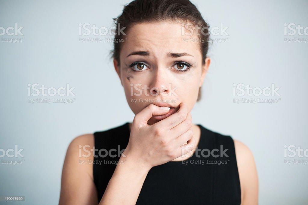The upset woman bites one's nails stock photo