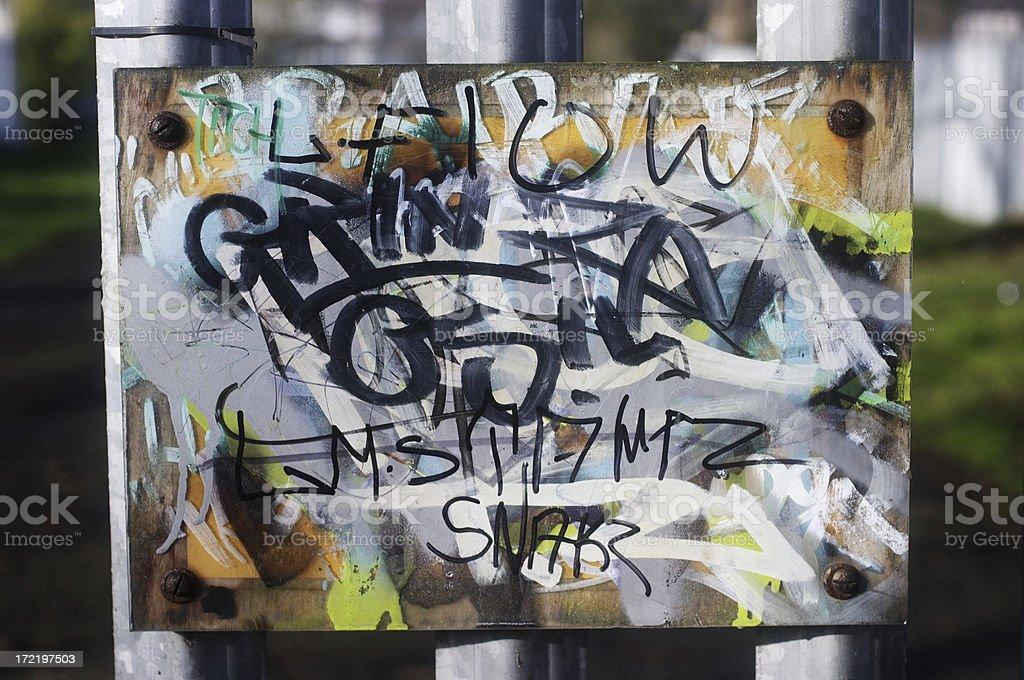 Public notice obliterated by graffiti stock photo