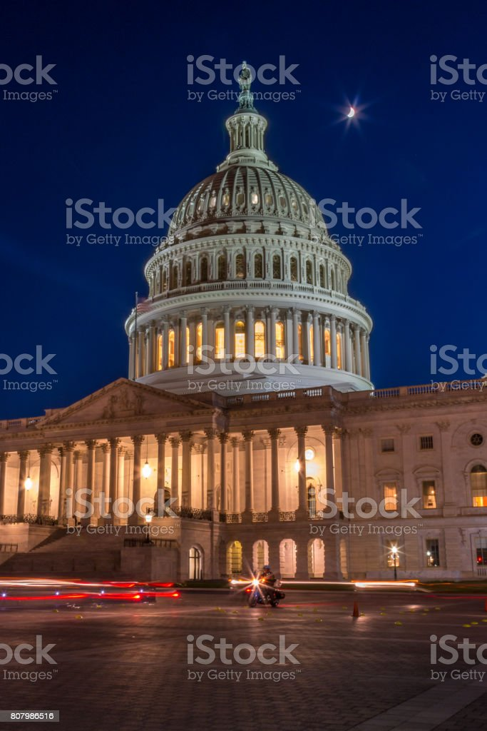 The US Capitol At Night With Moon Shining Up Above, Light Painting stock photo
