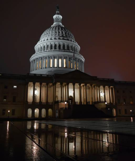 The US Capitol Building at Night in the Rain Washington DC stock photo