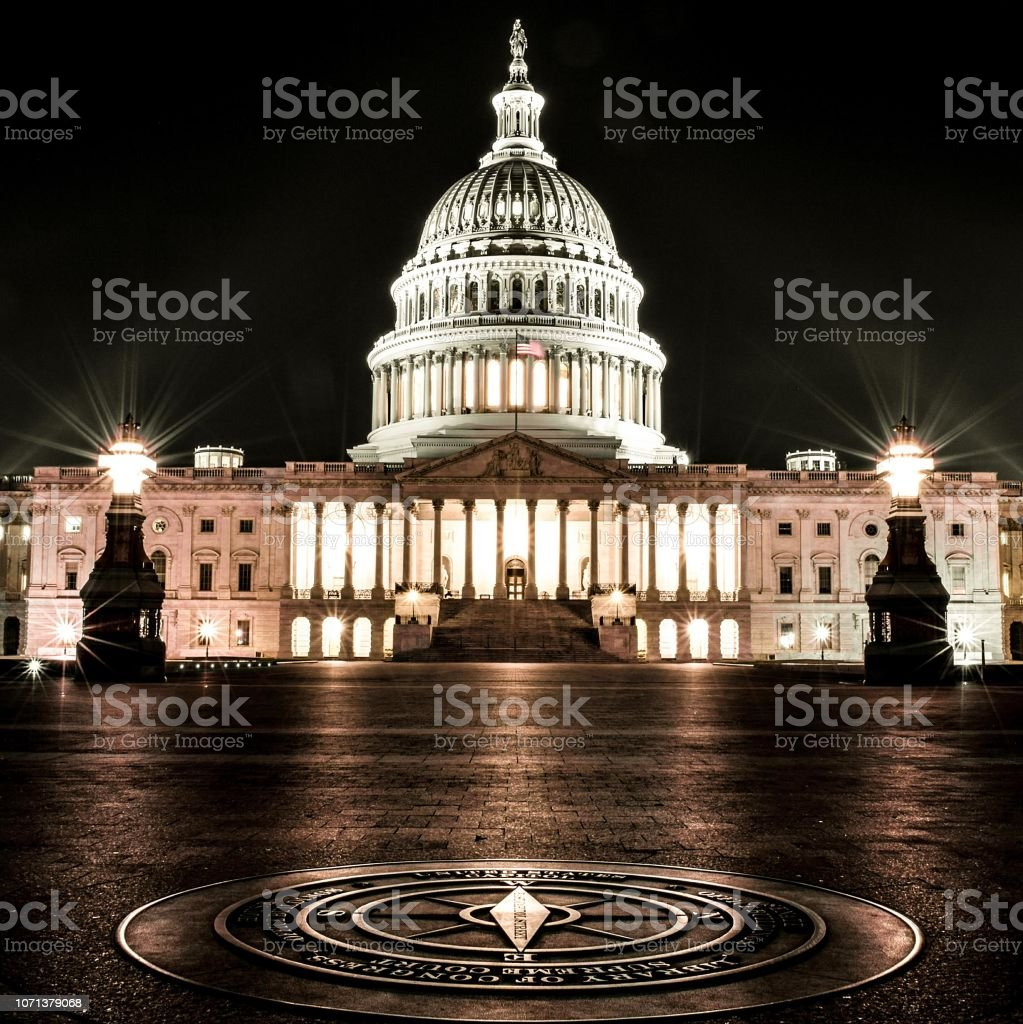 The U.S. Capitol Building at Night in Washington, D.C. stock photo