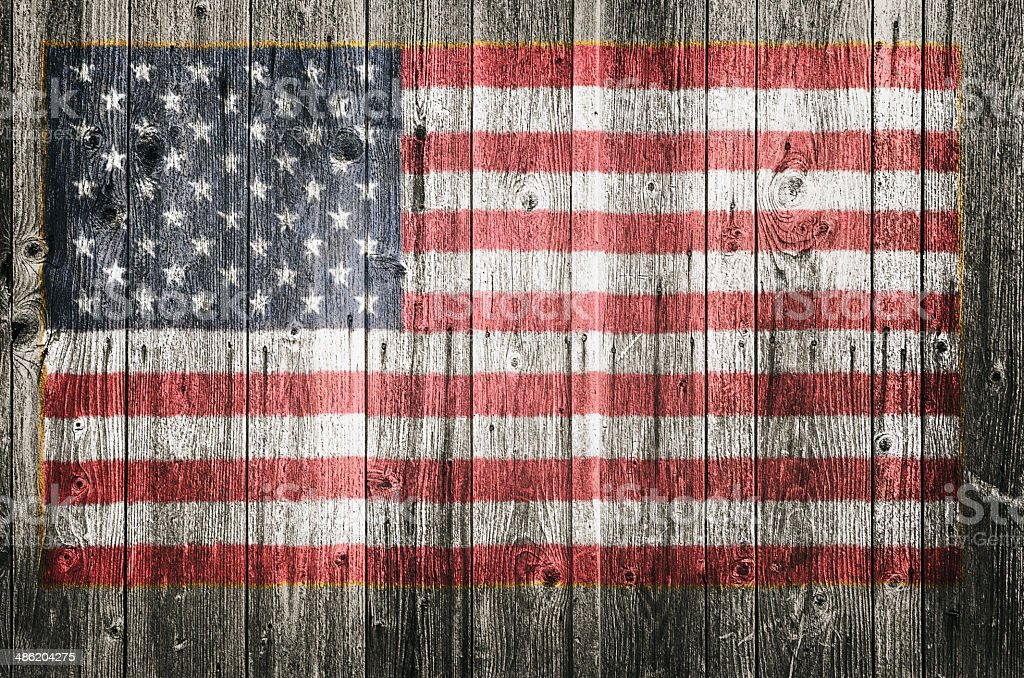 The USA flag painted on wooden plank stock photo