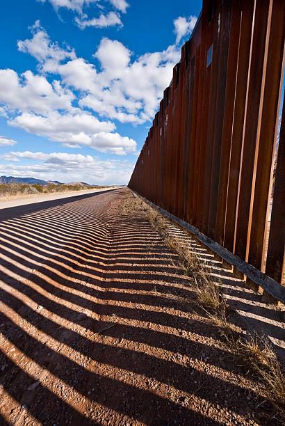 Shadows Cast Across the USA - Mexico Border stock photo