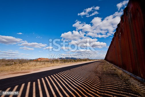 The USA-Mexico Border Fence separates people in Douglas, Arizona, USA from their neighbors and family in Agua Prieta, Sonora, Mexico.