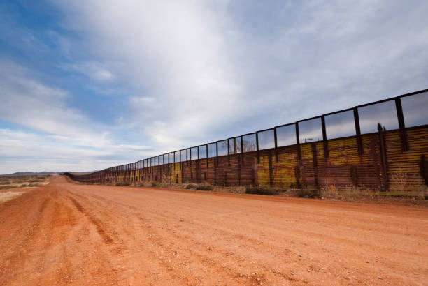 USA - Mexico Border Fence The USA-Mexico Border Fence separates people in Naco, Arizona, USA from their neighbors and family in Naco, Sonora, Mexico. international border barrier stock pictures, royalty-free photos & images