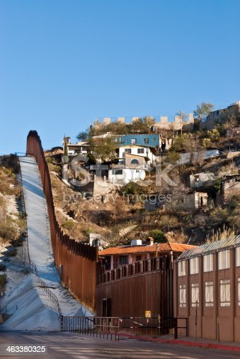The USA-Mexico Border Fence separates people in Nogales, Arizona, USA from their neighbors and family in Nogales, Sonora, Mexico.