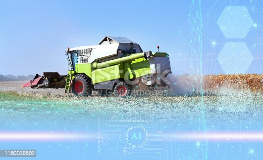 istock the use of artificial intelligence in agriculture, harvesting with a combine and increasing productivity, business growth 1180036502