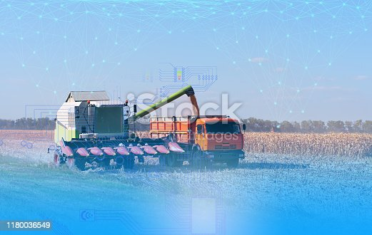 istock the use of artificial intelligence in agriculture, harvesting with a combine and increasing productivity, business growth 1180036549