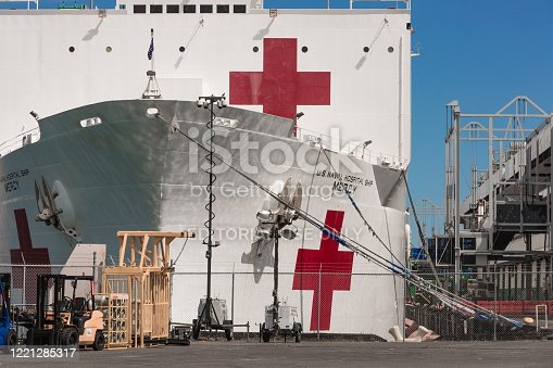 Los Angeles CA: 4/26/2020 - The USNS Mercy (T-AH-19) at the port of Los Angeles in San Pedro CA. USNS Mercy (T-AH-19) is the lead ship of her class of hospital ships in non-commissioned service with the United States Navy. Her sister ship is USNS Comfort (T-AH-20). She is the third US Navy ship to be named for the virtue mercy. In accordance with the Geneva Conventions, Mercy and her crew do not carry any offensive weapons, though defensive weapons are available. Attacking Mercy is a war crime.