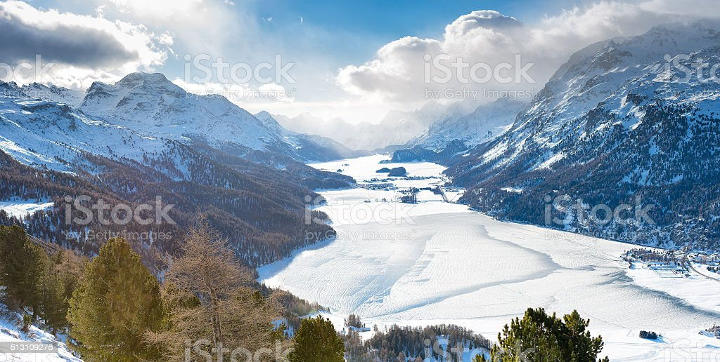 The valley of Engadine St. Moritz Switzerland with frozen lakes stock photo