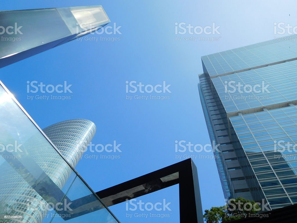 The valley of office buildings under the blue sky stock photo