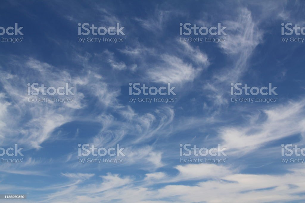The vast blue sky and clouds sky. blue sky background with tiny...