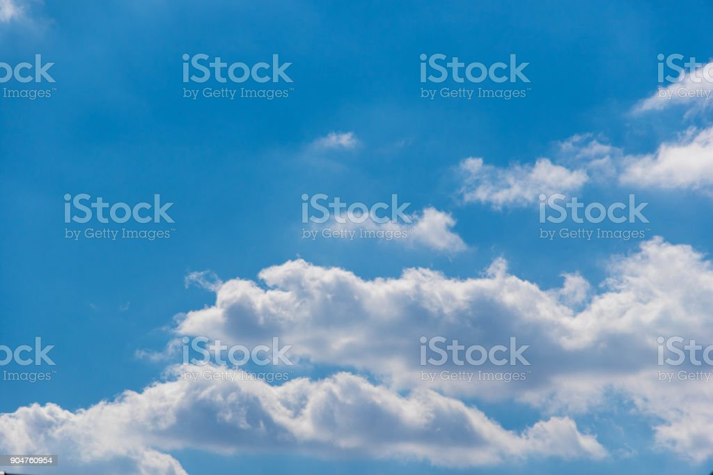 The vast blue sky and clouds sky stock photo