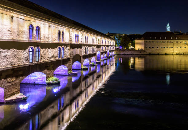 the vauban dam and commanderie saint-jean building at night in strasbourg, france. - barragem do roxo imagens e fotografias de stock