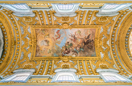 """The vault of the Basilica of the Santi Ambrogio e Carlo al Corso, with """"The Fall of the Rebel Angels"""" by Giacinto Brandi. In Rome, Italy."""