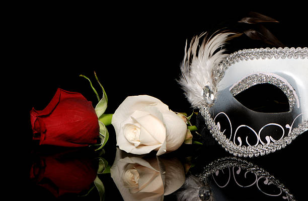 The Venetian mask and flowers on a black background stock photo