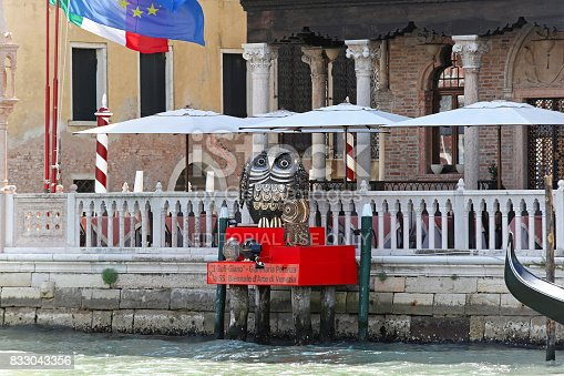 VENICE, ITALY - JULY 08: La Biennale in Venice on JULY 08, 2013. Bronze owls statues for 55th International Art Exhibition in Venice, Italy.