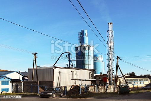 istock The ventilation system of the wood processing workshop. Metal construction for air circulation in a carpentry factory against a blue sky on a sunny day. Safety and working conditions in the enterprise 1064288468
