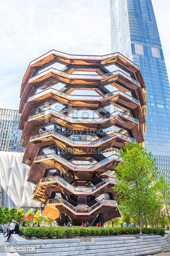 New York City, NY, USA - May 17, 2019: The Vessel, also known as the Hudson Yards Staircase designed by architect Thomas Heatherwick. Inside view with walking people