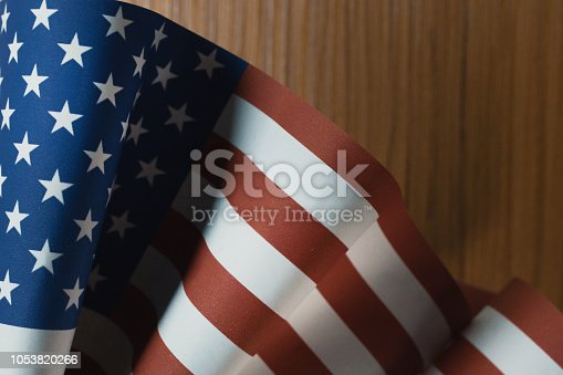 istock The Veterans Day  concept united states of America flag on wood background. 1053820266
