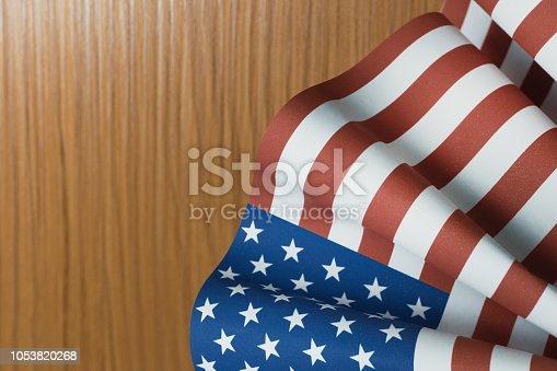 518726782 istock photo The Veterans Day  concept united states of America flag on wood background. 1053820268