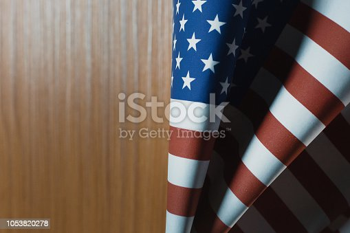 518726782 istock photo The Veterans Day  concept united states of America flag on wood background. 1053820278