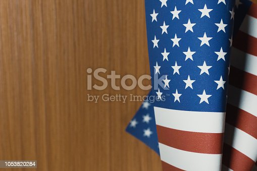 518726782 istock photo The Veterans Day  concept united states of America flag on wood background. 1053820284