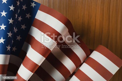 518726782 istock photo The Veterans Day  concept united states of America flag on wood background. 1053820330