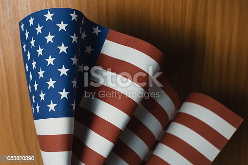 518726782 istock photo The Veterans Day  concept united states of America flag on wood background. 1053820390