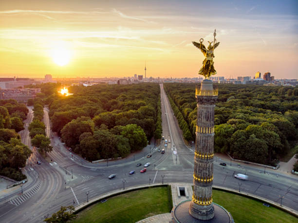 The victory column Tiergarten aerial view The Victory Column at the Tiergarten in Berlin during sunrise berlin stock pictures, royalty-free photos & images