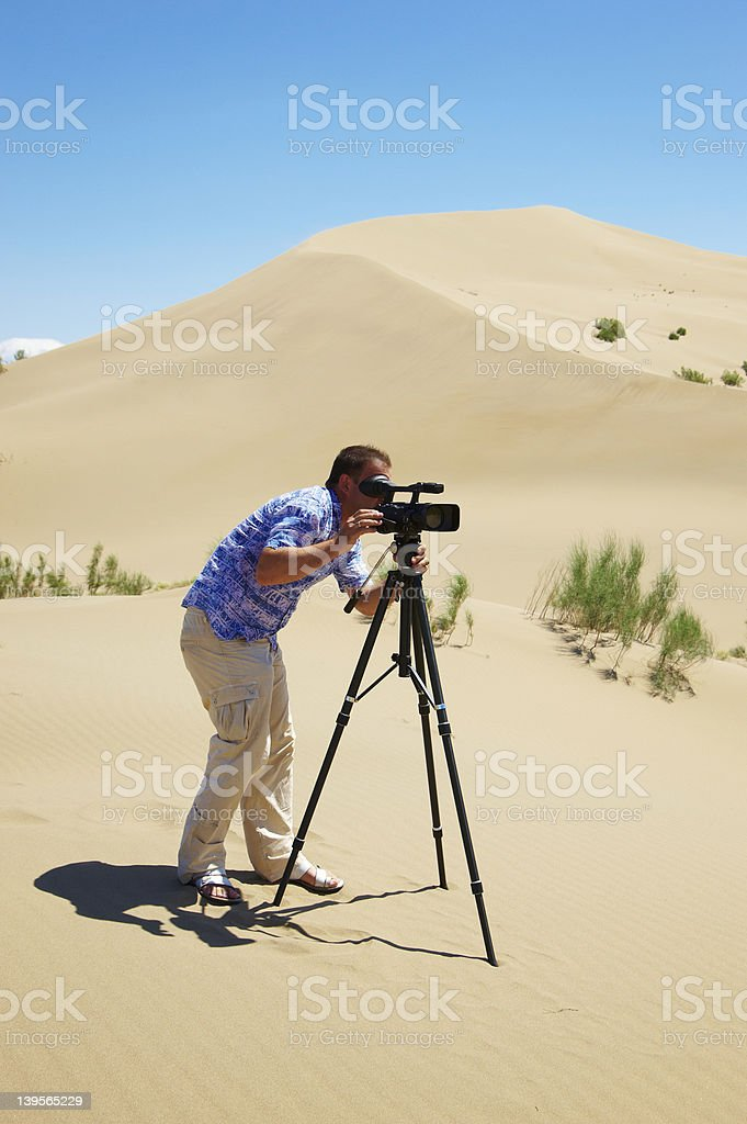 The video operator in desert royalty-free stock photo