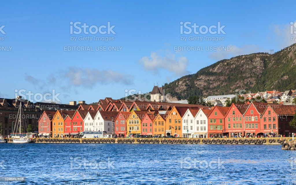 The view across Bergen harbour in Norway to the colourful buildings of Bryggen. stock photo